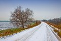 Rural road in winter with snow italian po valley running among cultivated fields Royalty Free Stock Photo