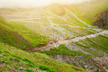 Rural roads, rocks and grass Royalty Free Stock Photo