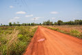 Rural routes red road in the countryside in thailand Stock Images