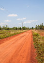 Rural routes red road in the countryside in thailand Royalty Free Stock Images