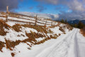 Rural Snowy Road in The Mountains Royalty Free Stock Images