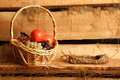 Rural still life. Basket of grapes and apples Stock Photo