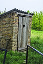 Rural toilet old in an extra yard Stock Photo