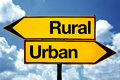 Rural or urban opposite signs two opposite road signs against blue sky background Stock Image