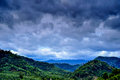 Rural view of mountain with raincloud