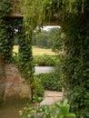 Rural view through old gateway Royalty Free Stock Photo