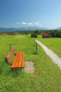 Rural walkway and bench, pictorial bavarian landscape Royalty Free Stock Photography