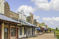 Rural western style shops a row of old with a bright blue sky in the background Stock Photography
