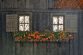 Rural wooden facade with windows and flowers in alps town Rhemes Notre Dame Royalty Free Stock Photo