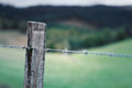 Rural wooden fence detail in the fields Stock Image