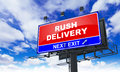Rush Delivery on Red Billboard. Royalty Free Stock Photo