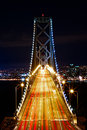 Rush hour on bay bridge at after sunset with san francisco skyline in the background Royalty Free Stock Image
