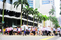 Rush hour in singapore unidentified businessmen crossing the street there are more than multinational corporations from us states Royalty Free Stock Photo