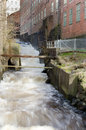 Rushing water down from a factory Royalty Free Stock Images