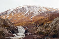 Rushing water mountain backdrop a river flowing down a mountainside Stock Photos
