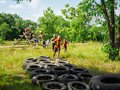 RUSSIA, Bryansk - June 30, 2018: Obstacle Race. Running through old used tires