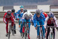 Russia, Izhevsk - April 24, 2017: A group of teens participating in a professional cycling race. Royalty Free Stock Photo