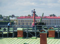 Russia saint petersburg july the peter and paul fortress officer to prepare for the midday shot explains guests safety Stock Photography