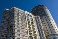 22.03.2017. Russia, Sverdlovsk Region, city of Yekaterinburg, a fragment of the building facade against the blue sky. Modern busin