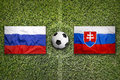 Russia vs. Slovakia flags on soccer field