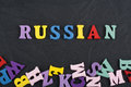 Russia word on black board background composed from colorful abc alphabet block wooden letters, copy space for ad text Royalty Free Stock Photo