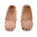 Russian bast shoes old isolated on white background focus on the front Royalty Free Stock Photo