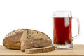 Russian brew in mug and loaf on white background of wheat rye flour wooden board isolated Stock Photo