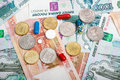 The russian currency and pills rouble banknotes coins Stock Photo