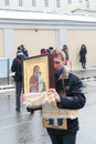 Russian demonstrator with orthodox icon Stock Image