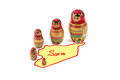 Russian dolls in syria wooden peasant dress with successively smaller ones fitted into it stand on the border of map on white Royalty Free Stock Photos