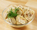 Russian dumplings boiled with meat on a wooden background in glass dish Stock Images