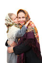 A russian girl in a headscarf is kissing mother isolated on white background Royalty Free Stock Image