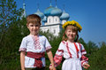 Russian little boy and girl on a orthodox church background Stock Image