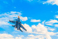 Russian military jet fighter flying in the blue cloudy sky Royalty Free Stock Photo