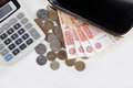 Russian money, calculator and purse Royalty Free Stock Photo