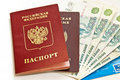 Russian money and passports Stock Photos