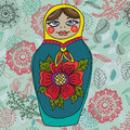 Russian nested doll matrioshka babushka color souvenir over floral background Stock Photo