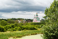 Of the Russian Orthodox Church near the river on a background of clouds Royalty Free Stock Photo