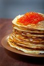 Russian pancakes  with red caviar Royalty Free Stock Image