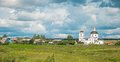 Russian province summer rural landscape with white church Stock Photography
