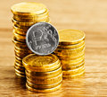 The russian rouble coin and gold money on desk Stock Photos