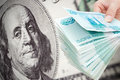 Russian rouble collapse big money against hundred dollar bill concept of Stock Photography