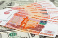 Russian roubles bills laying over dollars Stock Photography