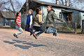 Russian rural schoolchildren during recess jumping rope tver russia may junior on the road near the school Royalty Free Stock Photography
