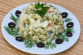 Russian salad olivier traditional in white plate Royalty Free Stock Photos
