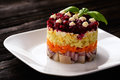 Russian salad with vegetables and herring. Royalty Free Stock Photo