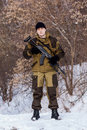 Russian soldier winter uniform kalashnikov machine gun forest background Royalty Free Stock Photo