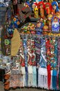 Russian souvenirs such as colorful shawls, scarves, painted matryoshkas, decorative small bags, purses and military headgear lie o Royalty Free Stock Photo