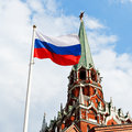 Russian state flag flying in wind with kremlin trinity tower on background Stock Photo