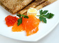 Russian traditional pancakes  with caviar Stock Images